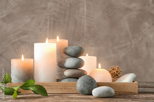 Wallpaper Mural Composition with spa stones on wooden table