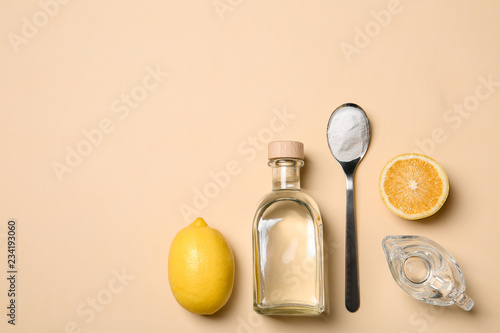 Flat lay composition with vinegar on color background. Space for text