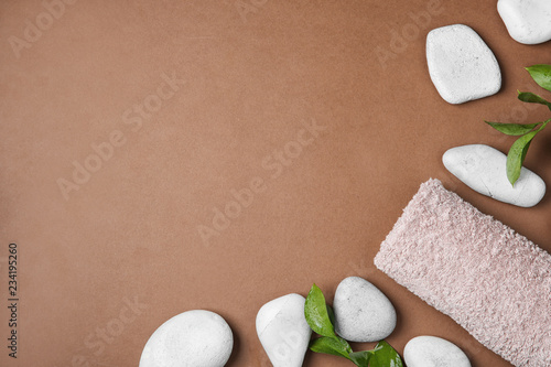 Flat lay composition with spa stones and space for text on color background