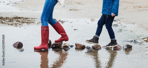 Fotografie, Obraz  People walking on stones at the beach