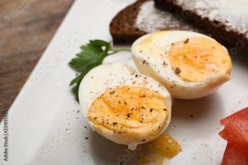 Cut soft boiled egg on plate, closeup