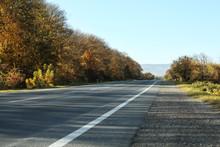 Asphalt Road Running Through Countryside On Sunny Day