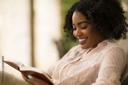 Fotografie, Obraz  African American woman studing and reading the Bible.