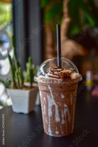 Valokuvatapetti Chocolate smoothie (milkshake) with jar in cafe