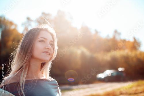 Fotografie, Tablou Pretty girl posing on camera and enjoying sunny autumn day.