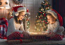 Children Opening Christmas Pre...
