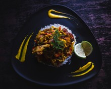 Delicious Chicken With Rice In A Gourmet Restaurant