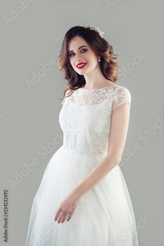 75c66a1d5 Cheerful bride woman in white wedding dress, studio portrait - Buy ...