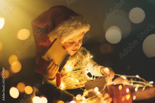 Fényképezés  Baby girl opening Christmas presents