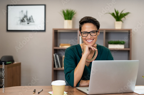 Successful business woman smiling