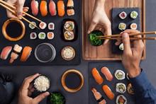 Sharing And Eating Sushi Food