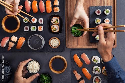 Fotobehang Sushi bar Sharing and eating sushi food