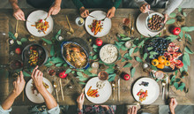 Traditional Christmas, New Year Holiday Celebration. Flat-lay Of Friends Or Family Eating Various Food At Festive Table With Turkey Or Chicken, Vegetables, Mushroom Sauce, Fruit, Top View