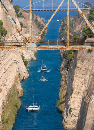Poster Amusementspark View from the bridge to the boats and View from the bridge to the boats and yachts passing through the Corinth Canal from a sunny day on Peloponnese in Greece