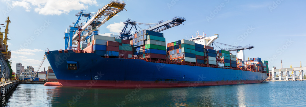 Fototapeta Container ship in port at container terminal. Ships of container ships stand in terminal of port on loading, unloading container.