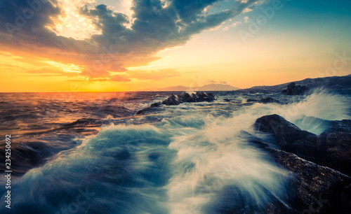 Printed kitchen splashbacks Cappuccino Beautiful seascape with rocks and waves at sunset