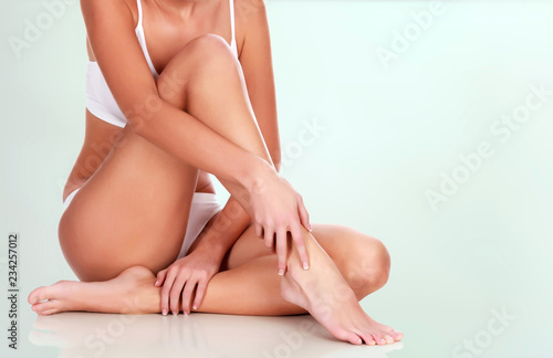 Fotografering Young woman with slim body and smooth clean skin