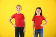 canvas print picture - Cute children in t-shirts on color background