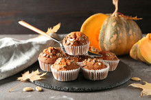 Delicious Pumpkin Muffins With Sunflower Seeds On Table