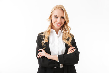 Obraz na PlexiPhoto of attractive businesswoman wearing office suit standing with arms crossed, isolated over white background in studio