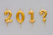 Happy New Year Question. Gold Shiny Number, Candles On Colored Background. Christmas , Festive Background.