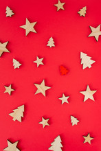 Christmas Or New Year Decorations ( Stars And Trees Made Of Wood ) On Red Background