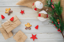 Some Christmas Presents In Decorative Boxes On A Wooden Background