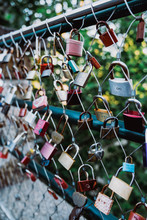 Love Locks Hanging On Fence