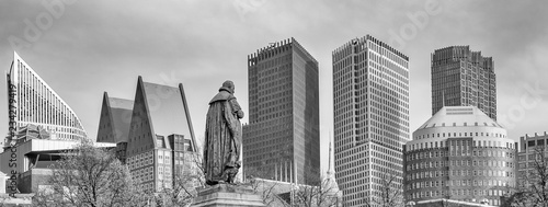 Panorama photo of the statue of William vam Orange on het Plein in the Hague with the sky-line in the background in black and white