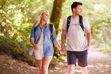 Couple Hiking Along Woodland P...