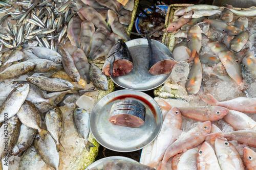 Deurstickers Asia land Sellers on the local market in Vietnam. Traditional food market in Hue, Vientam.