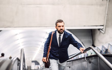 Hipster Businessman Using Escalator In Subway, Travelling To Work.