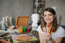 Adorable Young Artist Girl Hol...