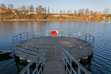Red Lifebuoy Hanging On Wooden Pier, Jordan Pond, Tabor, Oldest Dam In The Czech Republic, Sunny Autumn Day, Life Insurance Concept