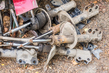 Car Part And Suspension Concept. Old Shock Absorbers. Old Car Dampers Pell-mell Piled.