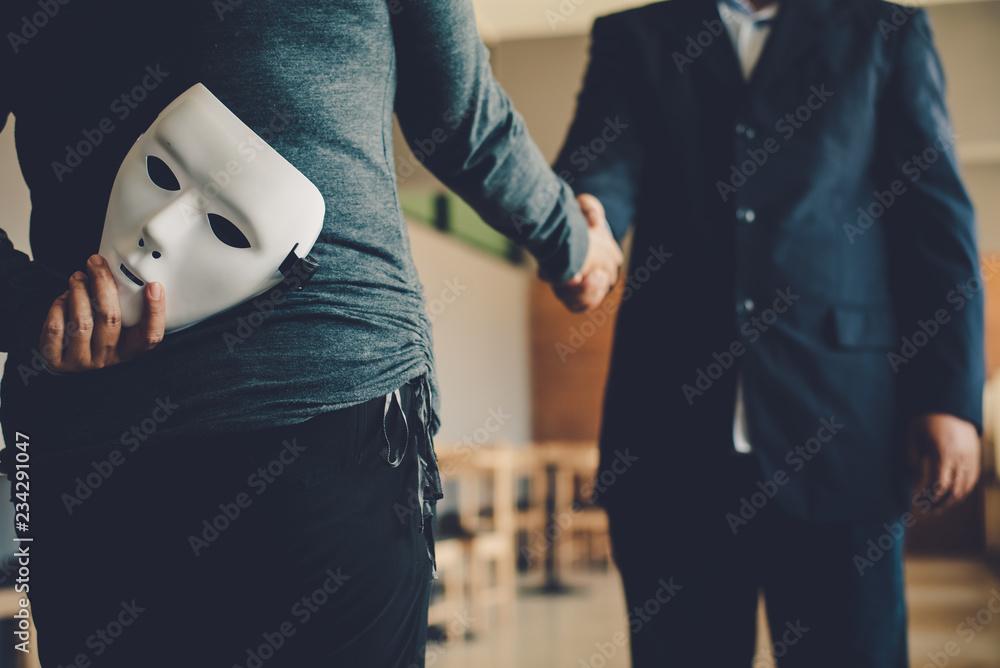 Fototapeta Masked, no sincerity of doing business together.