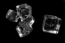 Five Transparent Ice Cubes Isolated On Black Background. 3D Rendering