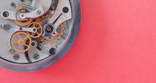 Mechanic Stopwatch Chronometer Mechanism, Spring Bronze Cogs Wheels Macro View. Shallow Depth Of Field, Selective Focus. Pink Background. Copy Space