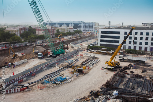 Foto op Plexiglas construction site with crane and steel or iron bars