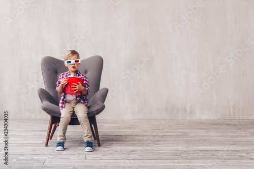 Little child in 3d glasses at home