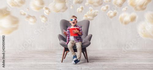 Surprised boy in 3d glasses in cinema