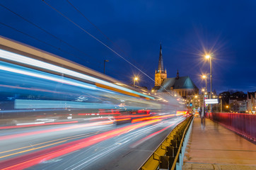 CITYSCAPE - Urban traffic at night on the bridge in Szczecin