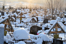 February 23, 2018 Moscow Region Crosses In A Cemetery, Monuments Of The Dead, A Cemetery In Winter, Wreaths, Artificial Flowers. Russia