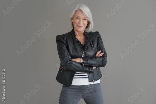 Fotografie, Obraz  Modern senior woman in leather jacket on isolated grey background
