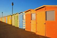 A Row Of Twenty Colorful Beach...