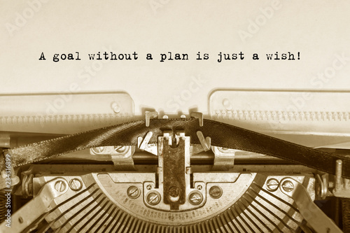 Fotomural A goal without a plan is just a wish!  typed words on a vintage typewriter with vintage background