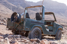 Old Rusty Jeep Stands Abandoned In The Mountains