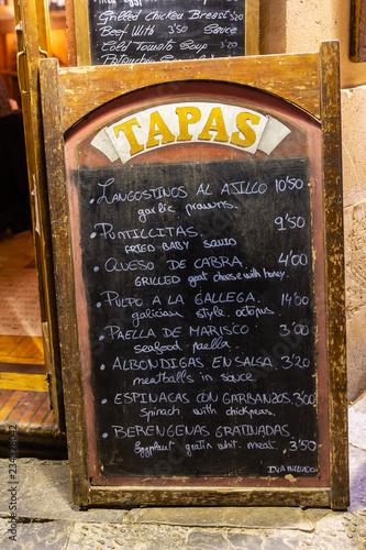 menu outside of a tapas bar in Seville, Spain