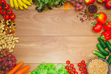 Go Vegan Concept Green Organic Vegetables & Bean On Wood Background.