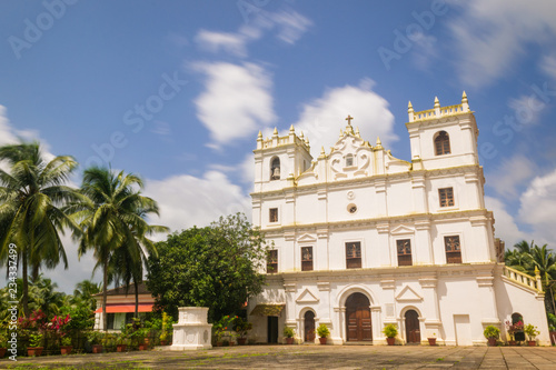 Photo Stands Havana Ancient St. Thomas church landscape in Aldona Goa surrounded by monsoon clouds